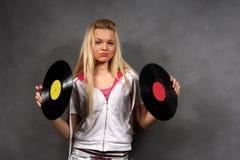 Menina na roupa dos esportes com vinil Imagem de Stock