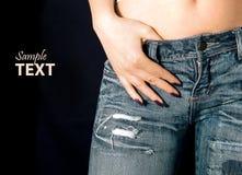 Menina nas calças de brim Fotos de Stock