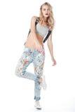 Menina nas calças de brim Imagem de Stock