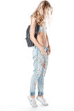 Menina nas calças de brim Fotografia de Stock Royalty Free