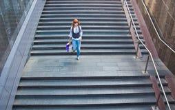 Menina nas escadas da passagem subterrânea Imagem de Stock Royalty Free