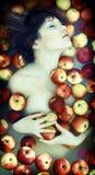 Menina nas maçãs Imagem de Stock Royalty Free