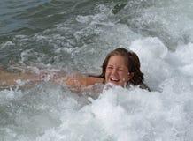 A menina nas ondas Imagem de Stock Royalty Free