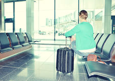 Menina no aeroporto Foto de Stock Royalty Free