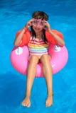 Menina no anel inflável Imagens de Stock Royalty Free