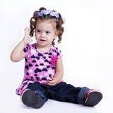 Menina no assento da camiseta Foto de Stock