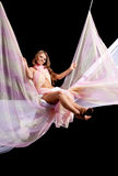 Menina no balanço com matéria têxtil da cor Imagem de Stock