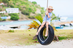 Menina no balanço do pneu Foto de Stock Royalty Free