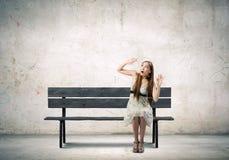 Menina no banco Imagens de Stock Royalty Free