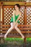 Menina no banco ao ar livre Imagem de Stock Royalty Free