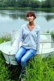 Menina no barco Fotografia de Stock