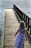 Menina no cais Imagens de Stock Royalty Free