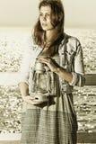 Menina no cais com lâmpada de querosene Fotos de Stock Royalty Free