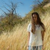 A menina no campo Fotos de Stock Royalty Free