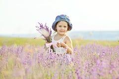 Menina no campo da alfazema Imagens de Stock Royalty Free