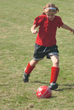 Menina no campo de futebol 1B Fotografia de Stock Royalty Free