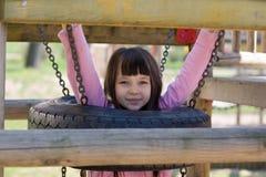 Menina no campo de jogos Fotografia de Stock Royalty Free