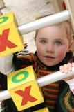 Menina no campo de jogos Imagens de Stock Royalty Free
