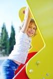 Menina no campo de jogos Imagem de Stock Royalty Free