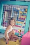 Menina no campo de jogos Fotografia de Stock