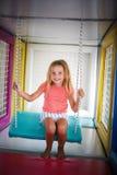 Menina no campo de jogos Foto de Stock Royalty Free