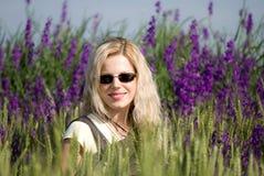 Menina no campo violeta Imagens de Stock Royalty Free