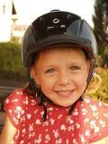Menina no capacete Fotografia de Stock