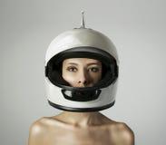 A menina no capacete branco Fotos de Stock Royalty Free