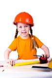 Menina no capacete da construção Fotografia de Stock
