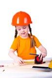 Menina no capacete da construção Imagem de Stock