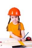 Menina no capacete da construção Imagens de Stock