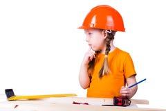 Menina no capacete da construção Fotos de Stock