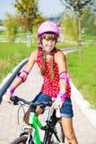 Menina no capacete protetor Fotos de Stock Royalty Free