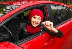 Menina no carro vermelho Fotos de Stock