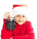 Menina no chapéu de Papai Noel Fotografia de Stock Royalty Free