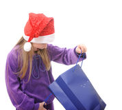 Menina no chapéu de Santa no fundo branco Imagem de Stock