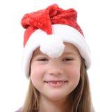 Menina no chapéu de Santa no fundo branco Fotografia de Stock Royalty Free