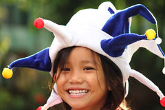 Menina no chapéu do palhaço imagem de stock royalty free