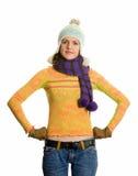Menina no chapéu e no lenço do inverno.   Imagens de Stock Royalty Free