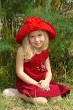 A menina no chapéu vermelho Fotografia de Stock Royalty Free