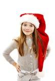 Menina no chapéu vermelho de Santa. Retrato imagem de stock royalty free