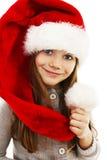 Menina no chapéu vermelho de Santa. Retrato fotos de stock royalty free