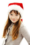 Menina no chapéu vermelho de Santa. Retrato fotografia de stock royalty free