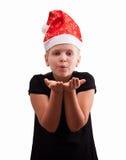 Menina no chapéu vermelho do Natal foto de stock
