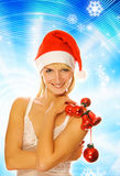 Menina no chapéu do Natal Fotos de Stock Royalty Free