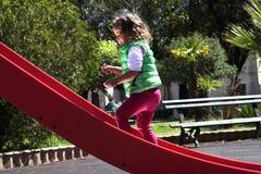 Menina no children& x27; monte de s Foto de Stock Royalty Free
