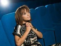 Menina no cinema Imagens de Stock