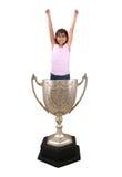Menina no copo do troféu imagens de stock royalty free