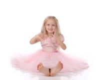Menina no dres cor-de-rosa imagem de stock