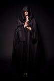 Menina no equipamento da freira Imagens de Stock